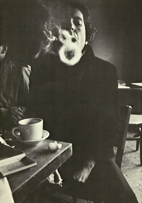 Leonard Cohen blowing smoke rings by Jim Wigler